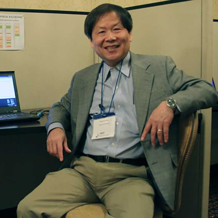 Dr Guo in front of computer